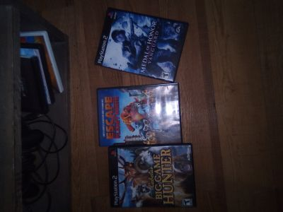 2 PlayStation 2 games and a movie