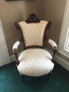 Antique chair matches love seat