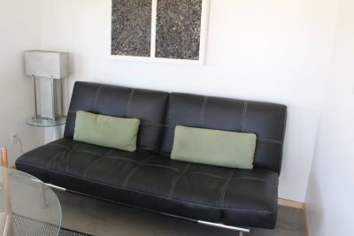 Black soft leather pull out couch.