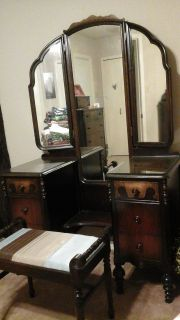 Antique vanity table with bench and matching highboy chest