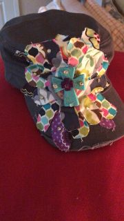 Super cute gray flower cap with turquoise cross in center! Velcro back