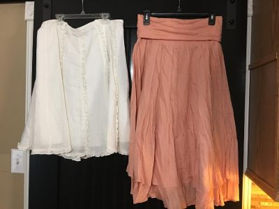 Size 12 and Large women s skirts. $5 for both