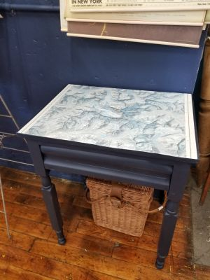 Blue side table with vintage map of Mt. Everest