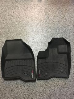 Weather Tech floormats for a 2011-2016 Ford Explorer.