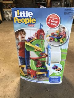 NEW IN BOX. Little people sit n stand skyway