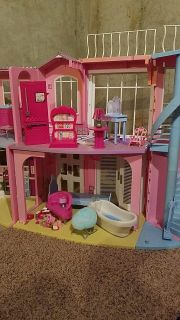 Barbie house with accessories.