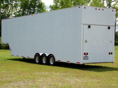 Stacker Trailer Hauls 3 Cars/Trucks