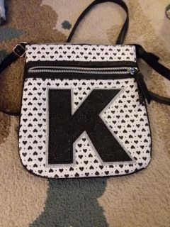 'K' Justice purse and assorted headbands