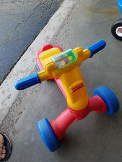 Fisher Price 3 wheel ride on toy