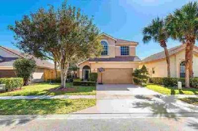 7693 Hoffy Circle Lake Worth Four BR, Beautiful pool home in