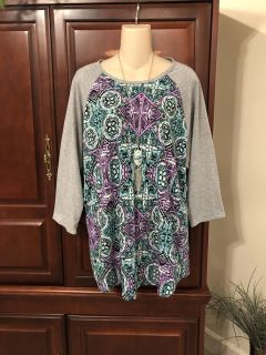 15.00 fits like a 1X LulaRoe Simply Comfortable gorgeous super comfy purple /aqua/Gray s triped top with 3/4 sleeves.