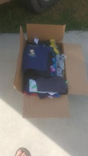 Box f baby clothes shoes and toys
