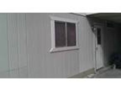 3 BR Two BA manufactured home with storage and fenced yard.
