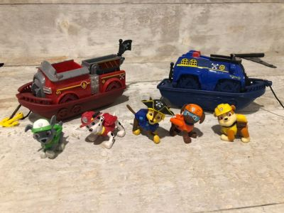 Paw patrol figurines and rescue boats