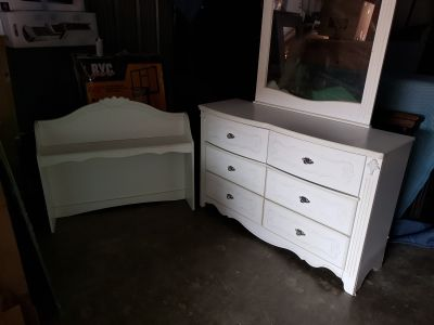 White wood dresser with a mirror and shelve topper
