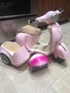 18 inch doll motorcycle scooter with dog seat and helmet- functional buttons and lights- hooks up with Bluetooth- $25- no holds PPU