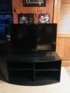 42 Sharp HD TV with black TV stand