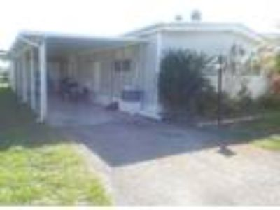 Large Double Wide 3/2 Mobile Home with Enclosed Patio and Garage FOR SALE at