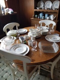 Table and 4 chairs and a hutch