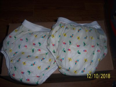 Potty training pants with plastic on outside