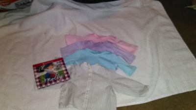 4 American girl tops and book.