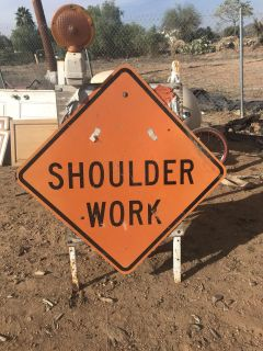 Construction signs and horses