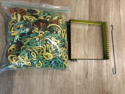 Loom and lots of loops to make pot holders.