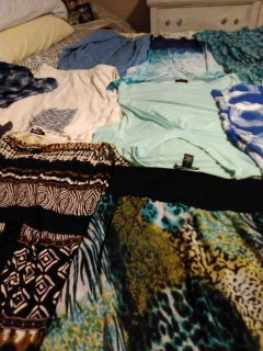 Two dresses and shirts,jacket,one pair of pants