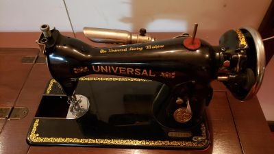 Vintage Universal Sewing Machine with portable Cabinet