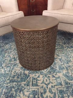 Very nice metal table-antique gold but could be painted-about 18 round, 18 tall