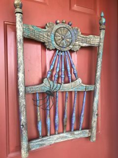 Rickety antique chair back. Perfect hung on a door or wall. The spider stays with me. The aged purple on this is fabulous!