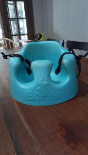Bumbo seat with buckles.