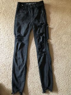 American Eagle high waisted ripped black jeans. Size 00. Smoke free pet free pet free home.