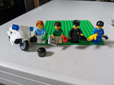 Set of 4 Authentic Lego Minifigures plus a motorcycle and helmet