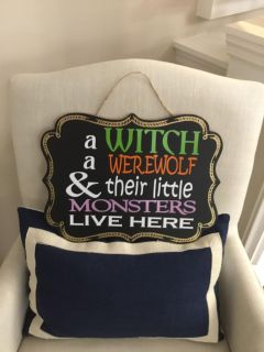 A witch a werewolf & their little monsters Live Here