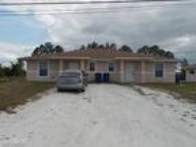 Three BR Two BA In Lehigh Acres FL 33973