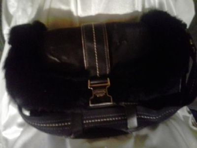 Authentic fur lined coach handbag