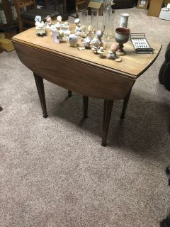 Drop leaf table with two sections for enlargement