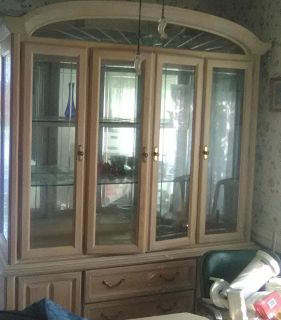 Beautiful curio/china cabinet bought new one owner paid $3500