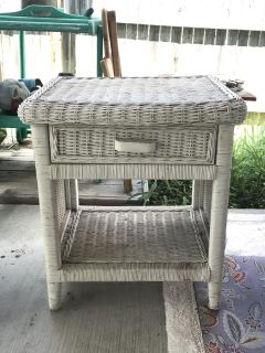 Wicker side table. Used outdoors. Quick sale in Dove Crossing!!!