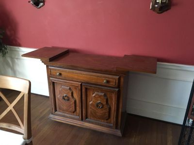 Nice dining room accent furniture with drawers and cabinet for storage.