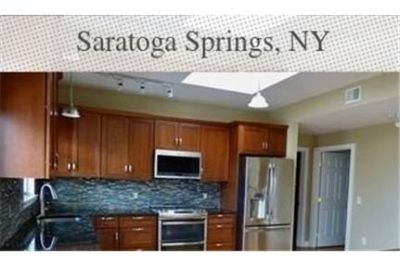 Spacious, immaculately kept condominium on the top fourth floor.
