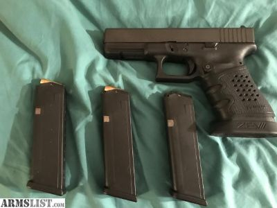 For Sale: Glock 22 Gen 3 40 S&W Pistol / 3/10 rd Mags/Zev Magwell/ Tear Drop Mag Release Button/ Manual/ Lock