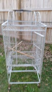 Large bird cage 4' tall on wheels