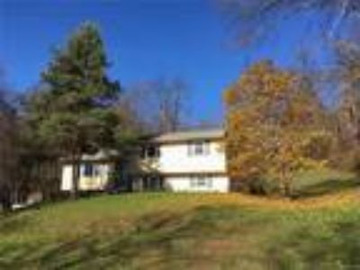 Real Estate For Sale - Four BR, Two BA Split level