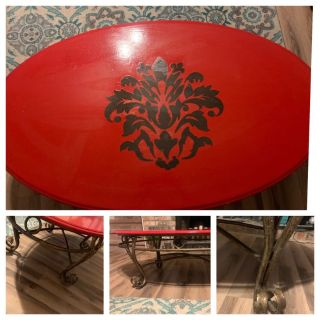 Oval red coffee table w bronze metal legs