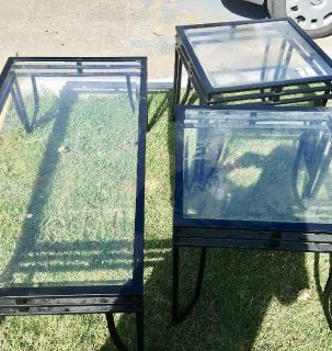 Glass and black metal coffee table and two end tables