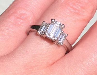 1.57 CTW Platinum three stone Diamond ring (valued at $12,330.00)