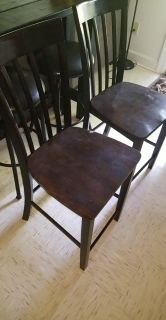 Set of wooden bar height chairs