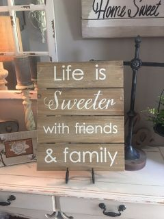 LIFE IS SWEETER with FRIENDS & FAMILY can be hung on a an easel like shown . It measures 20x16